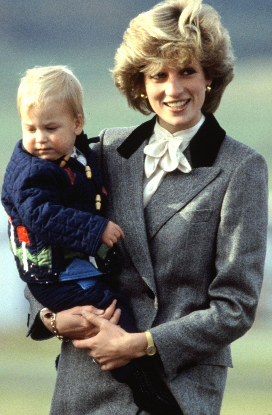<p>Princess Diana arrives at Aberdeen airport near Balmoral with Prince William.</p>