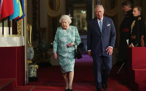 The Queen and Prince of Wales arrive at the opening of CHOGM together - Credit: Jonathan Brady /PA