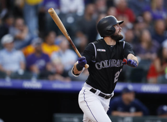 Colorado Rockies' David Dahl watches his two-run home run off San Diego Padres starting pitcher Cal Quantrill during the third inning of a baseball game Friday, June 14, 2019, in Denver. (AP Photo/David Zalubowski)