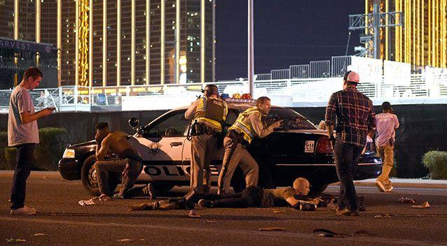 Las Vegas police stand guard along the streets outside the Route 91 Harvest country music festival grounds. Source: Getty Images