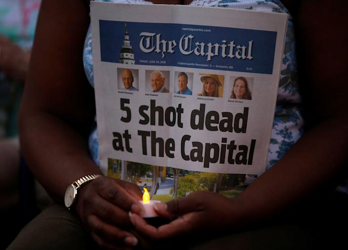 Five people were killed in the attack after police say the suspect, who had a long-standing grudge against the paper, opened fire in the Capital Gazette newsroom. (Photo: Leah Millis / Reuters)