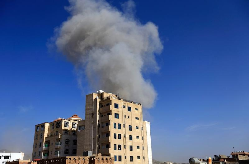 Smoke billows over the rebel-held Yemeni capital Sanaa as Saudi-led warplanes carry out air strikes following a rebel drone attack on a key Saudi oil pipeline (AFP Photo/Mohammed HUWAIS)