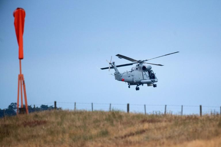 At first light, two military helicopters set off from Whakatane airport for the offshore volcano, where an eruption Monday killed at least 16 people and severely injured dozens more