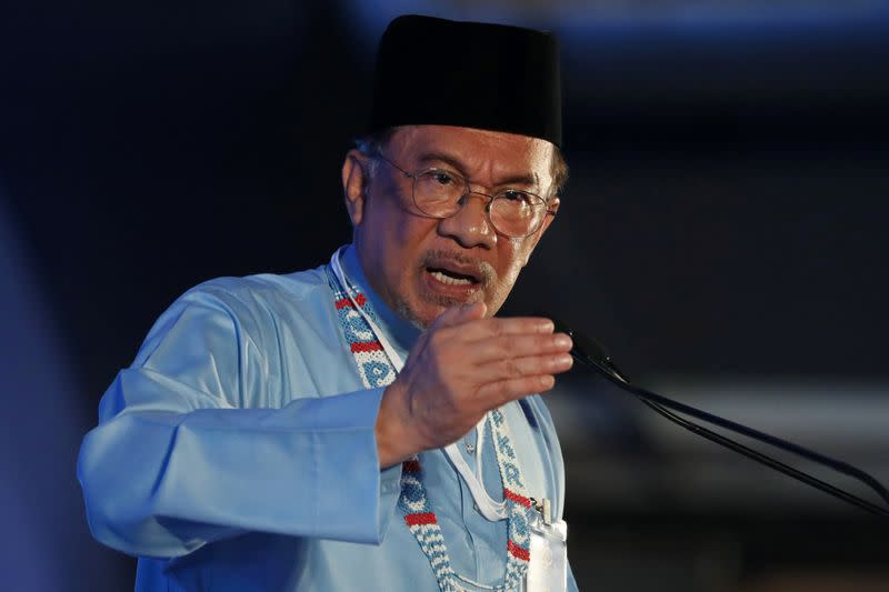 Malaysia's Anwar gives statement to police after denying sexual assault
