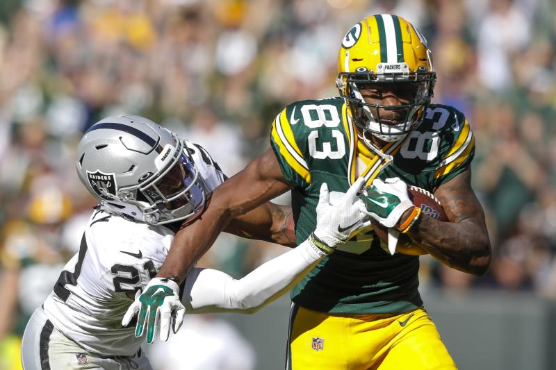 Green Bay Packers' Marquez Valdes-Scantling catches a long pass in front of Oakland Raiders' Gareon Conley during the second half of an NFL football game Sunday, Oct. 20, 2019, in Green Bay, Wis. (AP Photo/Jeffrey Phelps)