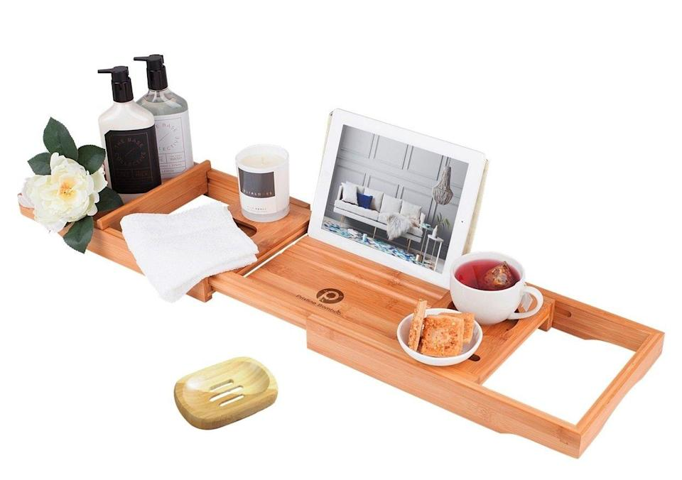 """<h2>Pristine Bamboo Bathtub Caddy</h2><br>If you can't be there to treat a loved one to a manicure or facial at their favorite salon, you can help bring a spa-like experience to their home with this top-rated bathtub caddy — it will accommodate creatures comforts like wine or a smartphone for a relaxing bathtime experience.<br><br><strong>Pristine Bamboo</strong> Bamboo Bathtub Caddy Tray, $, available at <a href=""""https://www.amazon.com/x2714-PREMIUM-Bamboo-Bathtub-Caddy/dp/B01LXTW6DS/ref=cm_cr_arp_d_product_top"""" rel=""""nofollow noopener"""" target=""""_blank"""" data-ylk=""""slk:Amazon"""" class=""""link rapid-noclick-resp"""">Amazon</a>"""
