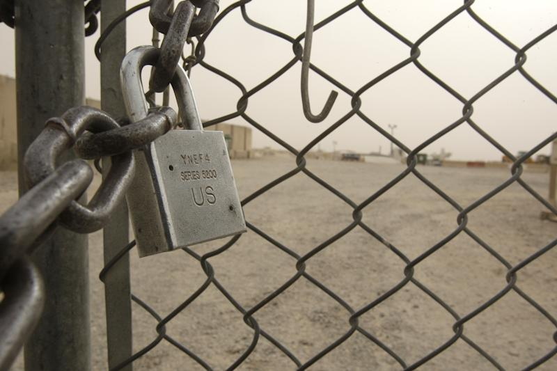 A gate is chained closed at the Speicher Contingency Operating Base on the outskirts of Tikrit, July 23, 2011