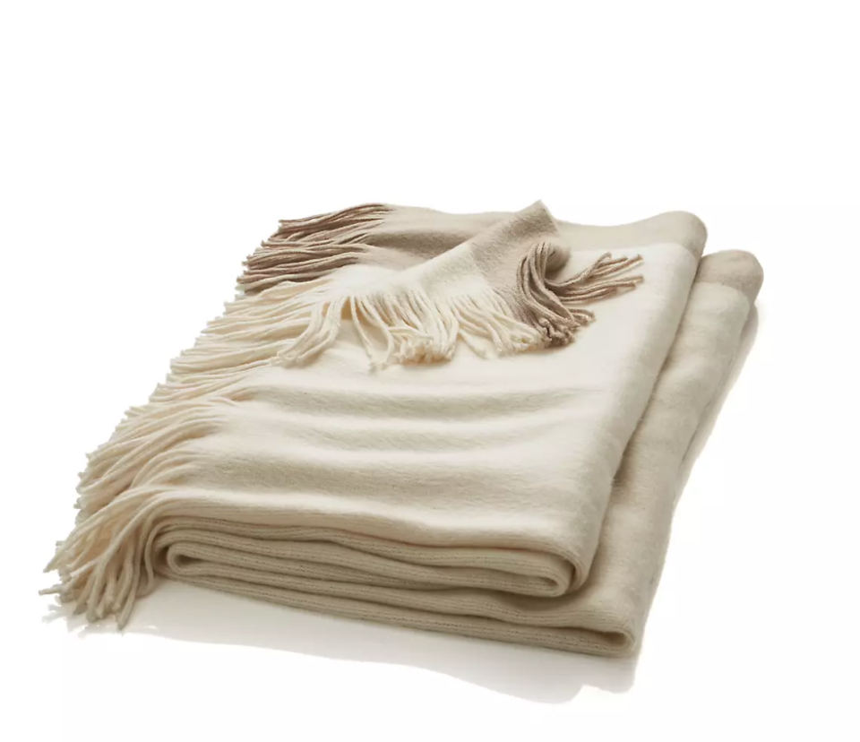 """<p>Crate & Barrel</p><p><strong>$39.95</strong></p><p><a href=""""https://go.redirectingat.com?id=74968X1596630&url=https%3A%2F%2Fwww.crateandbarrel.com%2Ftepi-natural-throw%2Fs631713%3Flocaledetail%3DUS%26storeid%3D636%26a%3D1552%26campaignid%3D10461646734%26adgroupid%3D103999388779%26targetid%3Dpla-324813037918%26pla_sku%3D631713%26pcat%3DHSW%26ag%3Dadult%26gclid%3DCjwKCAjwnPOEBhA0EiwA609ReSybMYixcxEe94lHTsRXCI8e1hcrcM2YszqhOm4jMJHVJ5YXhjZiNhoCkLYQAvD_BwE&sref=https%3A%2F%2Fwww.womansday.com%2Frelationships%2Fdating-marriage%2Fg36408636%2Fbridal-shower-gift-ideas%2F"""" rel=""""nofollow noopener"""" target=""""_blank"""" data-ylk=""""slk:Shop Now"""" class=""""link rapid-noclick-resp"""">Shop Now</a></p><p>This Crate & Barrel throw is as classy as it is cozy. Previous customers have enjoyed how light and soft it is, with some even comparing the material to cashmere.</p>"""