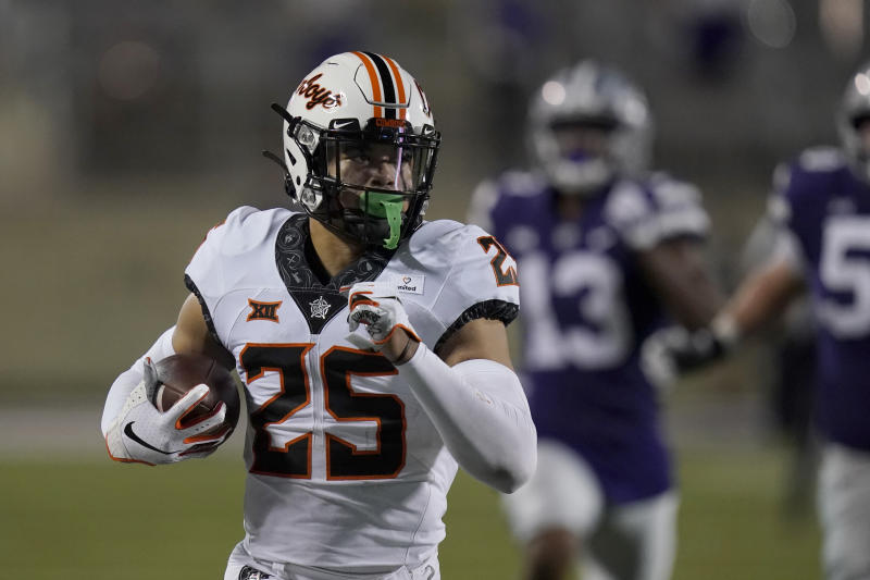 Oklahoma State safety Jason Taylor II (25) runs a recovered fumble 85 yards for a touchdown during the second half of an NCAA college football game against Kansas State in Manhattan, Kan., Saturday, Nov. 7, 2020. (AP Photo/Orlin Wagner)