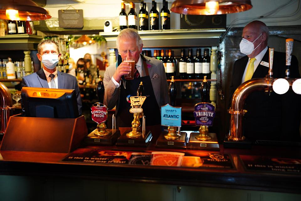 The Prince of Wales tries some Butty Bach (a Welsh term meaning 'little friend') ale during a visit to Ponthir House Inn (Ben Birchall/PA) (PA Wire)