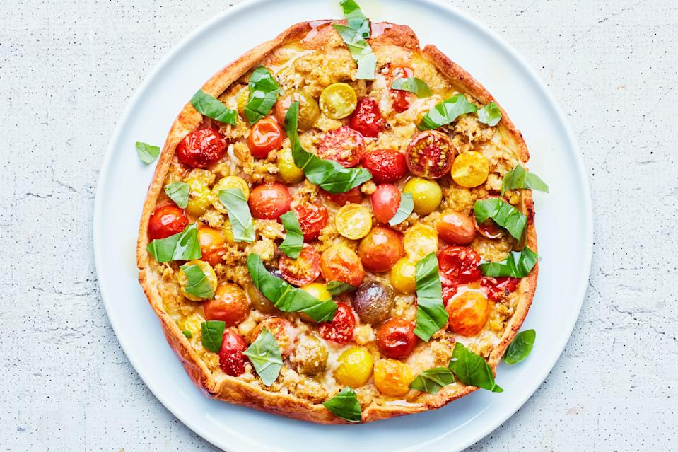 """A combination of pistachios and chickpeas adds filling protein and rich flavor to this update on the classic tomato tart. Pair it with <a href=""""https://www.epicurious.com/recipes/food/views/creole-caesar-salad-with-corn-bread-croutons?mbid=synd_yahoo_rss"""" rel=""""nofollow noopener"""" target=""""_blank"""" data-ylk=""""slk:this corn salad"""" class=""""link rapid-noclick-resp"""">this corn salad</a> or a classic arugula salad, and you'll be all set with a light summer meal. <a href=""""https://www.epicurious.com/recipes/food/views/tomato-tart-with-chickpea-crumble?mbid=synd_yahoo_rss"""" rel=""""nofollow noopener"""" target=""""_blank"""" data-ylk=""""slk:See recipe."""" class=""""link rapid-noclick-resp"""">See recipe.</a>"""