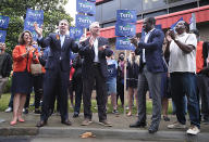 Virginia Governor Ralph Northam, second from left, talks about his endorsement in the Democratic gubernatorial primary of former governor Terry McAuliffe, third from left, during a quick rally outside the Office of the General Registrar, City of Richmond, in Richmond, Va. Friday, June 4, 2021. (Bob Brown/Richmond Times-Dispatch via AP)