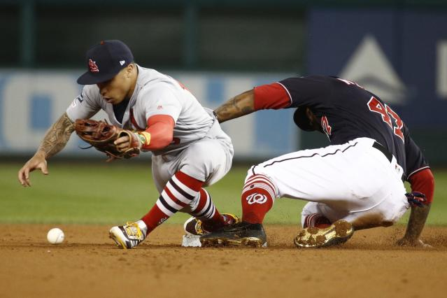 Washington Nationals' Howie Kendrick is safe at second as St. Louis Cardinals' Kolten Wong can't handle the ball during the first inning of Game 4 of the baseball National League Championship Series Tuesday, Oct. 15, 2019, in Washington. (AP Photo/Patrick Semansky)