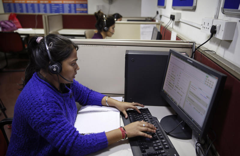 In this Dec. 2, 2013 photo, a staff member enters information after a call by a distressed woman on a government hotline established in the wake of last year's gang rape and murder of a young woman, in New Delhi, India. The government hotline is part of a wave of change since the case forced the country to confront its appalling treatment of women. New laws have made stalking, voyeurism and sexual harassment a crime. There is now a fast-track court for rape cases. In some ways, the case cracked a cultural taboo surrounding discussion of sexual violence in a country where rape is often viewed as a woman's personal shame to bear. (AP Photo/Saurabh Das)