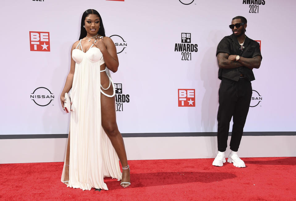Megan Thee Stallion, left, and Pardison Fontaine arrive at the BET Awards on Sunday, June 27, 2021, at the Microsoft Theater in Los Angeles. (Photo by Jordan Strauss/Invision/AP)