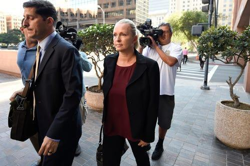 FILE - In this Thursday, Aug. 23, 2018 file photo, Margaret Hunter, center, the wife of U.S. Rep. Duncan Hunter, arrives for an arraignment hearing in San Diego. Rep. Duncan Hunter's wife is planning to change her not-guilty plea after the couple was charged with using more than $250,000 in campaign funds on vacations and other expenses. Margaret Hunter, who worked as the California Republican's campaign manager, is scheduled to appear in federal court Thursday, June 12, 2019 to change her plea.(AP Photo/Denis Poroy) ORG XMIT: FX102