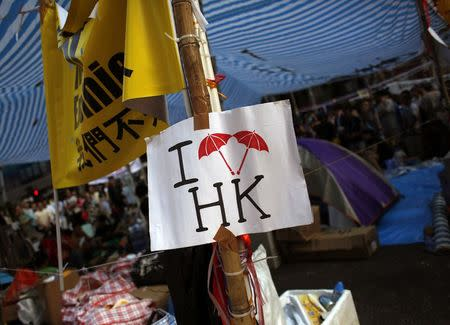 A sign featuring umbrellas, which has become a symbol of the pro-democracy demonstrators, is displayed in a tent built on Nathan Road, the main north-south route of Kowloon peninsula, which has been blocked by pro-democracy protesters at Hong Kong's Mongkok shopping district October 7, 2014. REUTERS/Bobby Yip