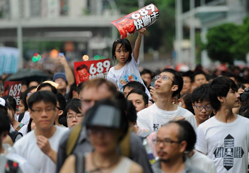 A child holds up a banner during a pro-democracy rally in Hong Kong, on July 1, 2014