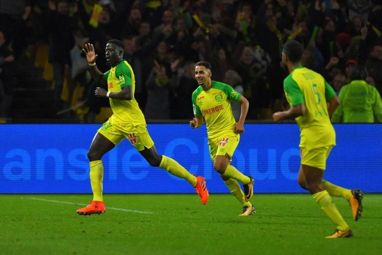 Nantes' Abdoulaye Toure (1st-L) celebrates after scoring a goal during their match against Guingamp at the La Beaujoire stadium in Nantes, western France, on October 21, 2017