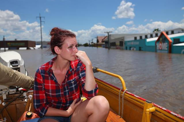 BUNDABERG, AUSTRALIA - JANUARY 29: Local Storm Green looks on from a boat while shops are underwater as parts of southern Queensland experiences record flooding in the wake of Tropical Cyclone Oswald on January 29, 2013 in Bundaberg, Australia.Four deaths have been confirmed and thousands have been evacuated in Bundaberg as the city faces it's worst flood disaster in history. Rescue and evacuation missions continue today as emergency services prepare to move patients from Bundaberg Hospital to Brisbane amid fears the hospital could lose power. (Photo by Chris Hyde/Getty Images)