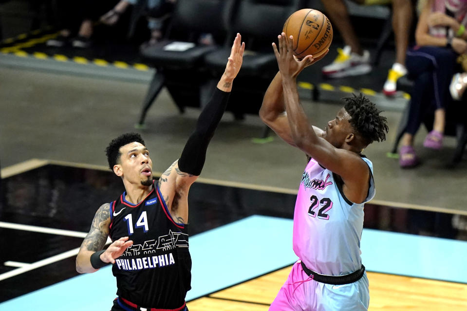 Miami Heat forward Jimmy Butler (22) shoots over Philadelphia 76ers forward Danny Green (14) during the first half of an NBA basketball game Thursday, May 13, 2021, in Miami. (AP Photo/Lynne Sladky)