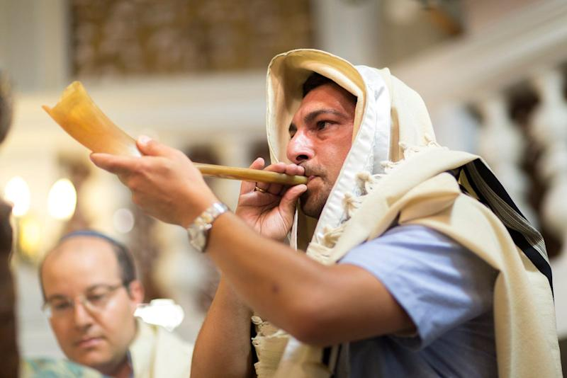 """A Tokea (which literally means """"blaster"""") blows into a shofar in the Conegliano Synagogue in Jerusalem to announce the Jewish New Year, Rosh HaShanah (meaning """"head of the year"""" in Hebrew)"""