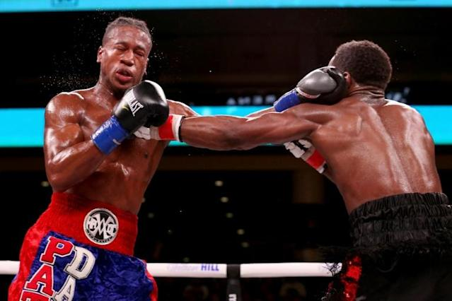 Patrick Day, here exchanging punches with Charles Conwell in their super welterweight bout in Chicago on October 12, 2019, has died of brain injuries suffered in his knockout defeat (AFP Photo/Dylan Buell)