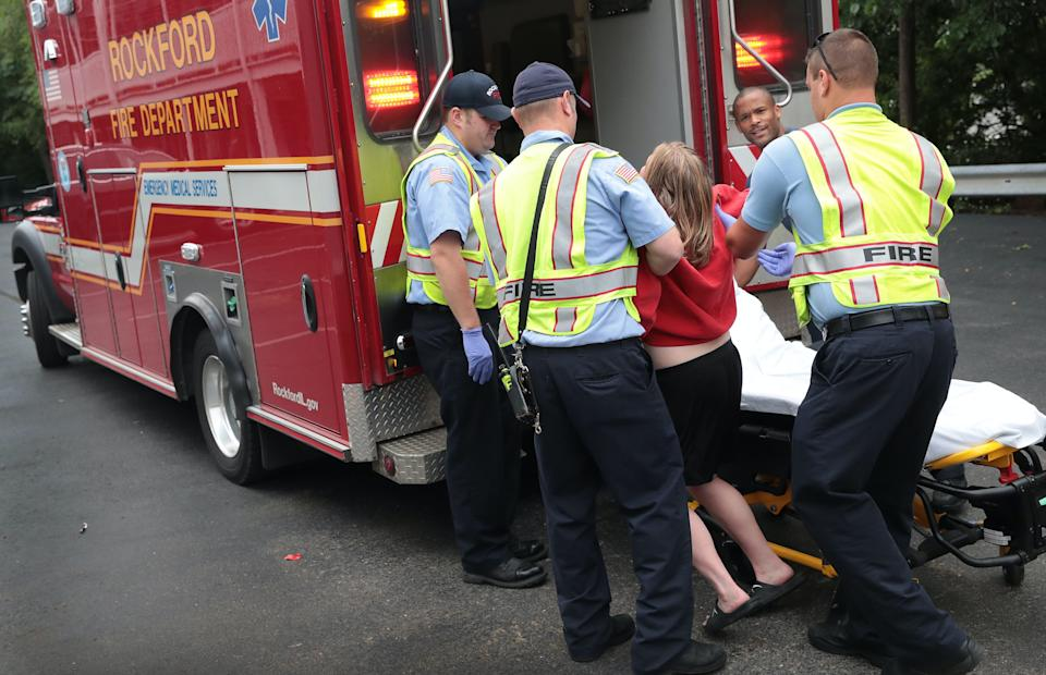 Firefighters help an overdose victim on July 14, 2017 in Rockford, Illinois. (Photo: Scott Olson/Getty Images)
