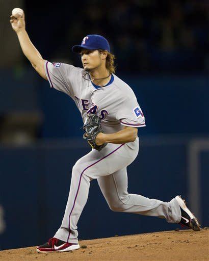 Texas Rangers starter Yu Darvish pitches to the Toronto Blue Jays during the first inning of a baseball game in Toronto on Monday, April 30, 2012. (AP Photo/The Canadian Press, Frank Gunn)