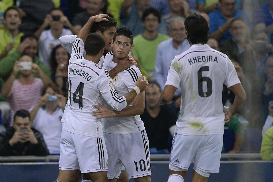Real Madrid's Raphael Varane (C) is congratulated by teammates after scoring a goal during their Spanish Copa del Rey (King's Cup) match against UE Cornella, at the Power8 stadium in Cornella-El Prat, near Barcelona, on October 29, 2014 (AFP Photo/Josep Lago)