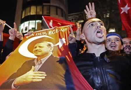 Demonstrators gather outside the Turkish consulate in Rotterdam