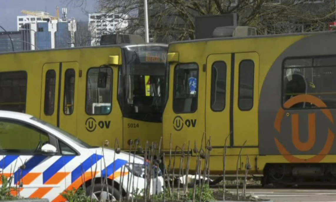 In this image taken from video, a body lays next to a tram as emergency services attend the scene of a shooting in Utrecht, Netherlands, Monday March 18, 2019. (Photo: Peter Dejong/AP)