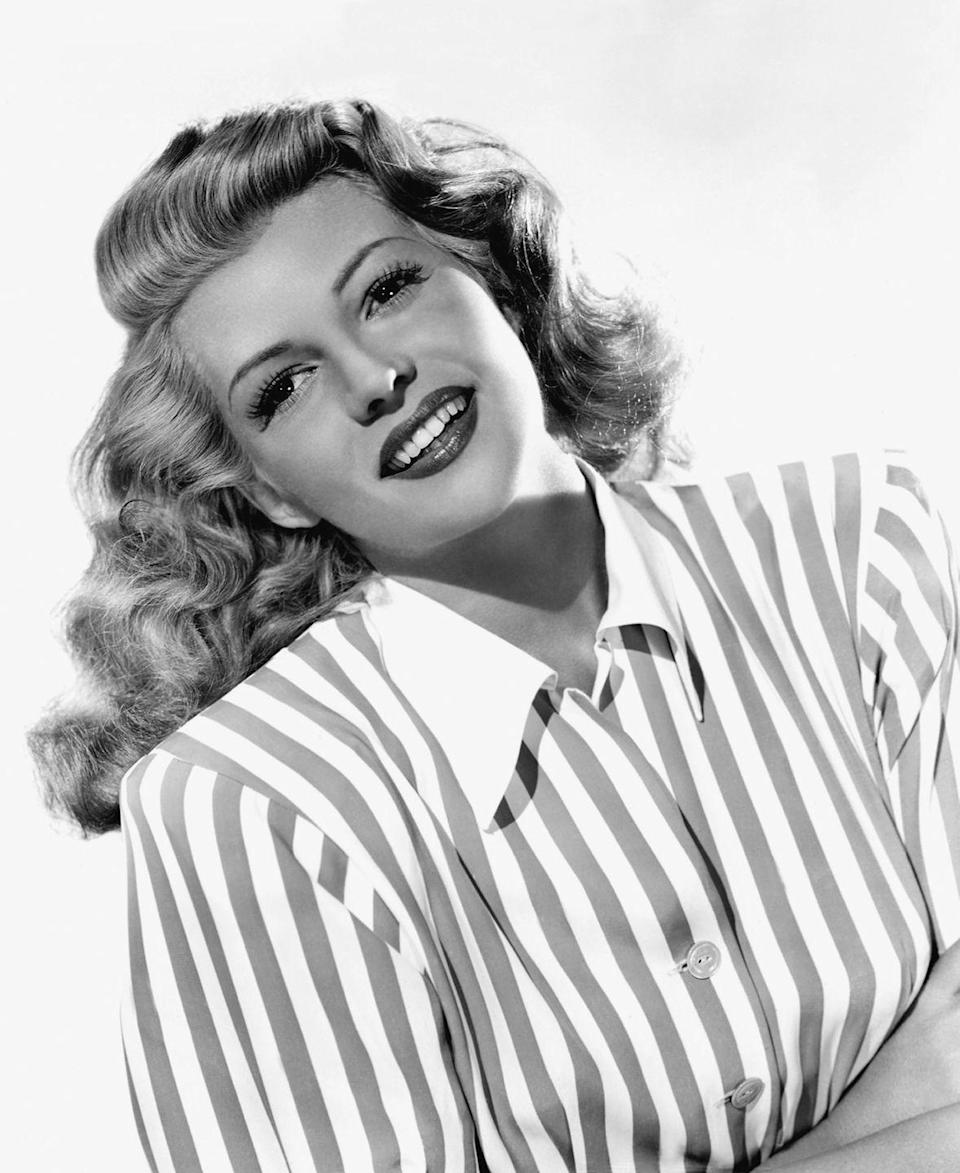 """<p>A softer curled style stayed popular throughout the era, with stars like Rita Hayworth maintaining a <a href=""""http://www.goodhousekeeping.com/beauty/hair/a32799/side-part-hair-trend-tutorial/"""" rel=""""nofollow noopener"""" target=""""_blank"""" data-ylk=""""slk:deep side part"""" class=""""link rapid-noclick-resp"""">deep side part</a> and full waves.</p>"""