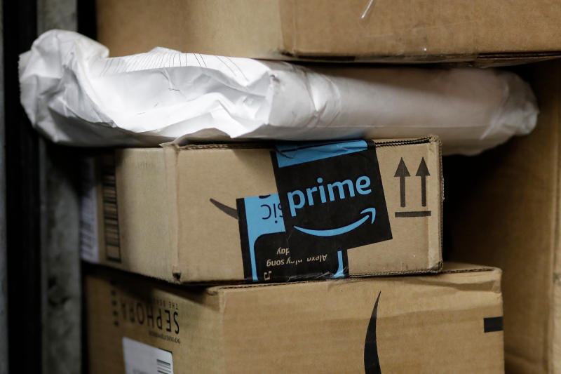 FILE- In this May 9, 2017, file photo, a package from Amazon Prime is loaded for delivery in New York. Amazon's Prime Day starts July 16, 2018, and will be six hours longer than last year's and will launch new products. (AP Photo/Mark Lennihan, File)