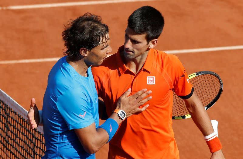 FILE PHOTO:  Novak Djokovic hugs Rafa Nadal following his 7-5 6-3 6-1 victory in the French Open quarter-finals at Roland Garros in Paris.