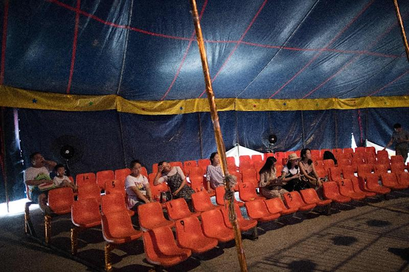 The members of the Chinese Prosperous Nation Circus Troupe say they will do what they have to do to keep their tradition alive, despite falling attendances (AFP Photo/NICOLAS ASFOURI)