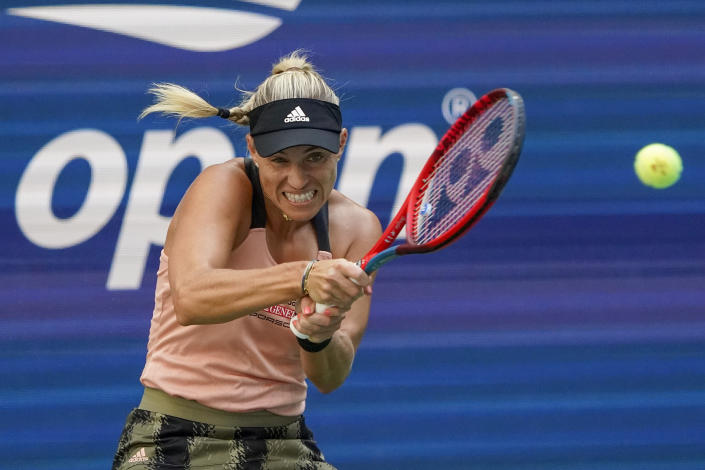 Angelique Kerber, of Germany, returns a shot to Anhelina Kalinina, of Ukraine, during the second round of the US Open tennis championships, Thursday, Sept. 2, 2021, in New York. (AP Photo/Elise Amendola)