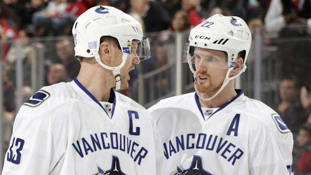 "With a combined 2,106 points, Daniel and <a class=""link rapid-noclick-resp"" href=""/nhl/players/2103/"" data-ylk=""slk:Henrik Sedin"">Henrik Sedin</a> are among the highest-scoring brothers in NHL history. (Getty)"