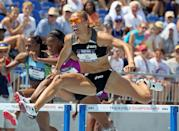 Lolo Jones clears a hurdle on the way to victory in the Womens 100 Meter Hurdles during the 2010 USA Outdoor Track & Field Championships at Drake Stadium on June 26, 2010 in Des Moines, Iowa. (Photo by Andy Lyons/Getty Images)