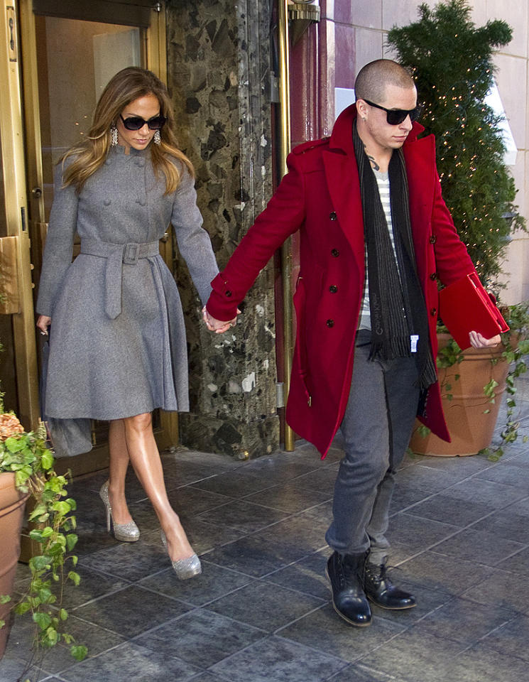 J.Lo bundled up in the frigid NYC weather with a gray wool trench and matching pumps as she and Casper -- in a red pea coat -- left their Manhattan hotel later that afternoon. (1/30/2011)