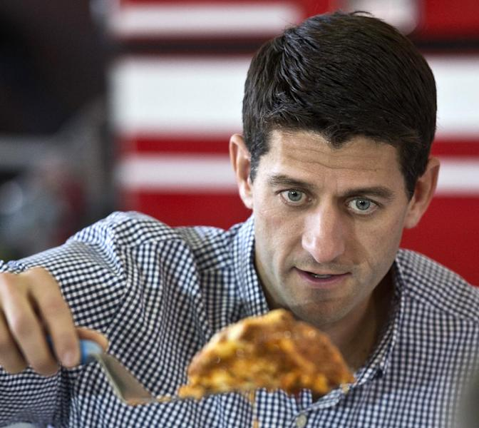 Republican vice presidential candidate, Rep. Paul Ryan, R-Wis. serves some lasagna during a lunch with firefighters, Tuesday, Sept. 11, 2012, in Oak Creek, Wis. (AP Photo/Morry Gash)