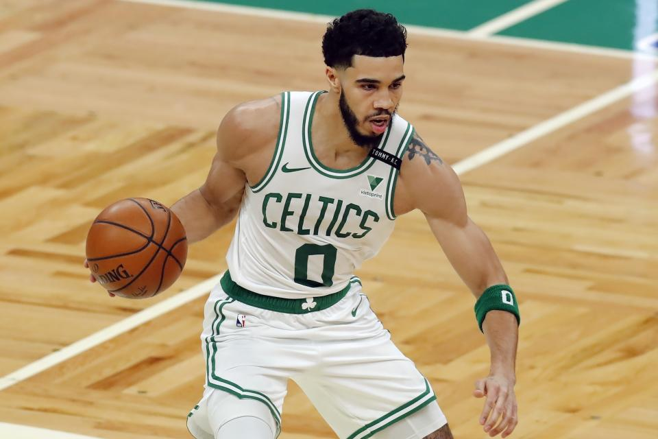 Boston Celtics' Jayson Tatum plays against the Orlando Magic during the first half on an NBA basketball game, Sunday, March 21, 2021, in Boston. (AP Photo/Michael Dwyer)