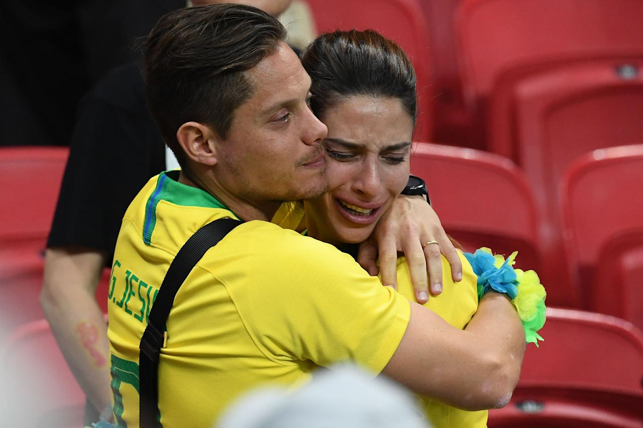 <p>Brazil fans react to their loss during the Russia 2018 World Cup quarter-final football match between Brazil and Belgium at the Kazan Arena in Kazan on July 6, 2018. – Belgium beat World Cup favourites Brazil 2-1 on Friday to set up a semi-final against France in Saint Petersburg. (Photo by Jewel SAMAD / AFP) </p>