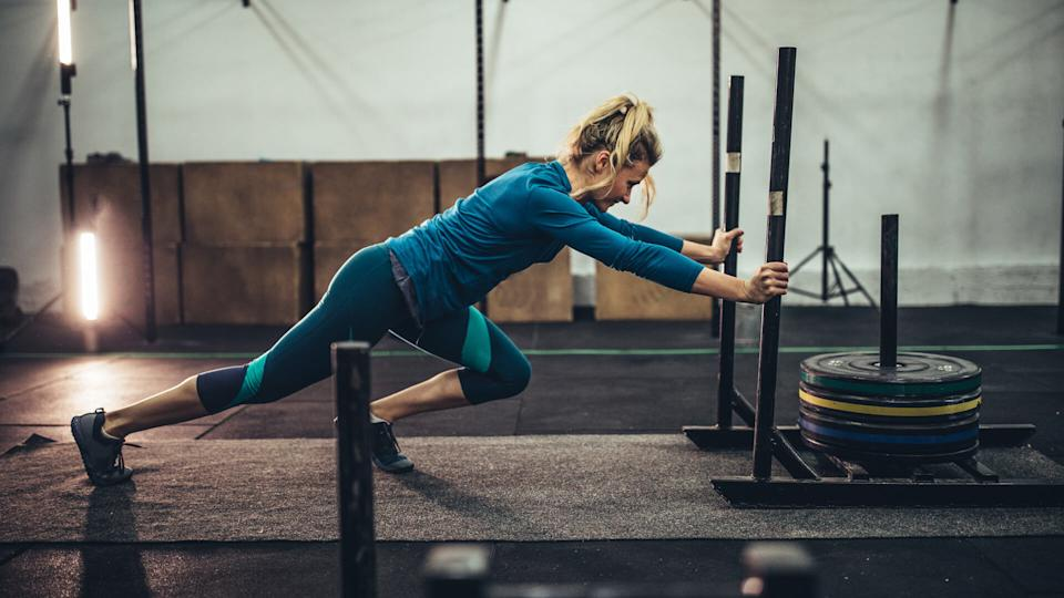 Woman exercising with weights in the gym.