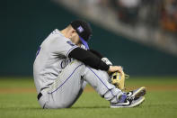 Colorado Rockies shortstop Trevor Story pauses on the field after he threw to first but was unable to put out Washington Nationals' Carter Kieboom during the fourth inning of a baseball game, Friday, Sept. 17, 2021, in Washington. (AP Photo/Nick Wass)