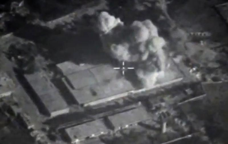 An image made available on November 23, 2015, purports to show an explosion after airstrikes carried out by Russian air force on what Russia says was an Islamic State facility in the Syrian province of Idlib