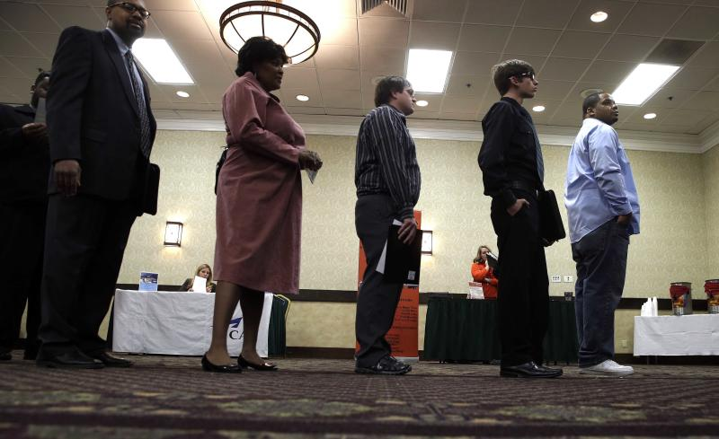 In this Wednesday, Jan. 22, 2014, photo, job seekers line up to meet a prospective employer at a career fair at a hotel in Dallas. Two straight weak job reports have raised doubts about economists' predictions of breakout growth in 2014. The global economy is showing signs of slowing again. (AP Photo/LM Otero)