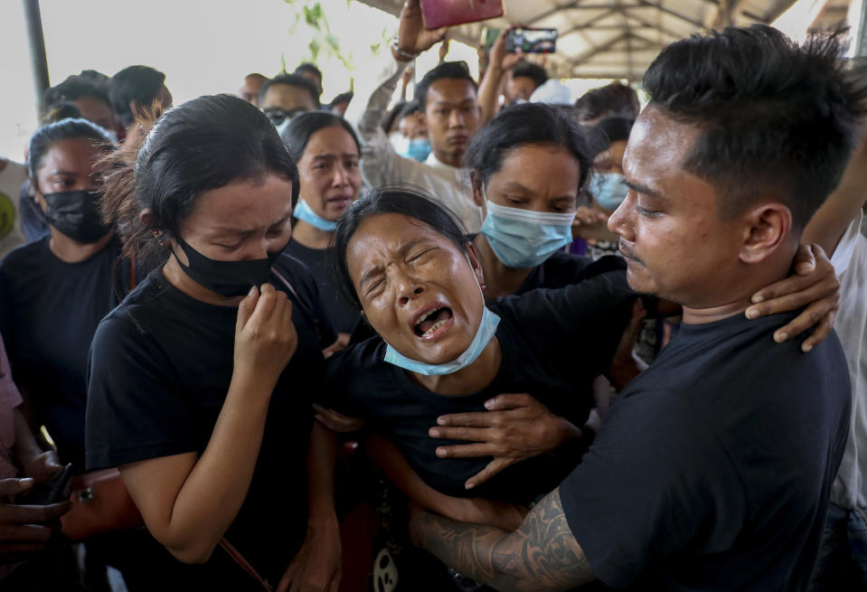 FILE - In this Feb. 23, 2021, file photo, Thida Hnin cries during the funeral of her husband Thet Naing Win at Kyarnikan cemetery in Mandalay, Myanmar. Thet Naing Win was shot and killed by Myanmar security forces during an anti-coup protest on Feb. 20. (AP Photo)