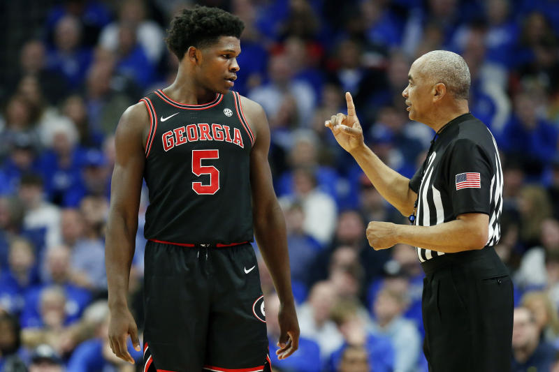 Georgia's Anthony Edwards (5) confers with referee Tony Greene during an NCAA college basketball game against Kentucky in Lexington, Ky., Tuesday, Jan 21, 2020. Kentucky won 89-79. (AP Photo/James Crisp)