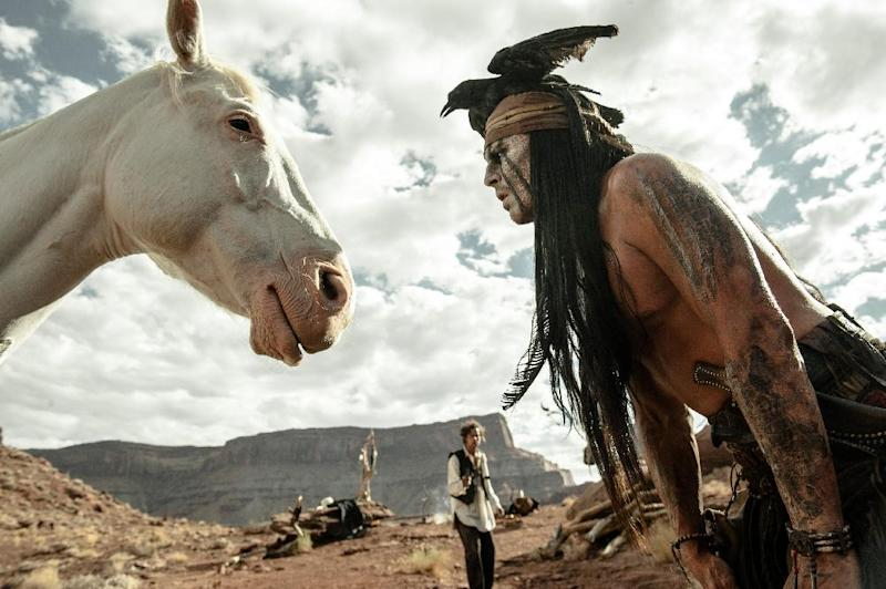 """This publicity image released by Disney shows Johnny Depp as Tonto, right, and Armie Hammer as The Lone Ranger, in a scene from """"The Lone Ranger."""" (AP Photo/Disney Enterprises, Inc. and Jerry Bruckheimer Inc., Peter Mountain)"""